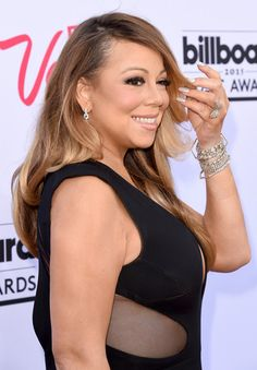 Mariah Carey Photos - Singer Mariah Carey attends the 2015 Billboard Music Awards at MGM Grand Garden Arena on May 17, 2015 in Las Vegas, Nevada. - 2015 Billboard Music Awards - Arrivals