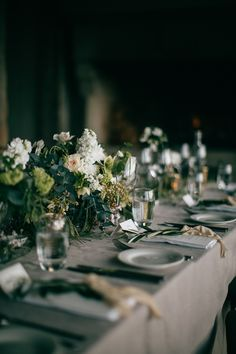 organic wild centerpieces for the wedding reception | image via: magnolia rouge