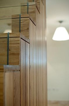 Oak staircase with timber 'through' the glass and a recessed illuminated hand rail. Via User submission.