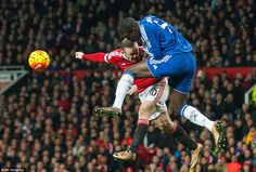 Manchester United captain Rooney and Kurt Zouma compete for the ball as they do battle during an aerial challenge