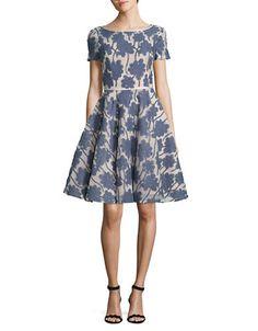 """<ul><li>Breathable fit-and-flare dress featuring bold florals</li><li>Boatneck</li><li>Short sleeves</li><li>Fit-and-flare silhouette</li><li>Pleated skirt</li><li>Back zipper closure</li><li>About 38"""" from shoulder to hem</li><li>Polyester</li><li>Dry clean</li><li>Imported</li><li>This item will arrive with..."""