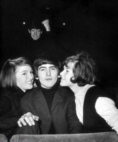 Paul McCartney photo bombing George Harrison.