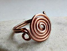 Learn How to Make a Spiral Wire Ring that shines all on its own! You'll be hypnotized by this cool coiled ring design. Transfer the techniques demonstrated in this wire ring tutorial to other wire work jewelry projects.