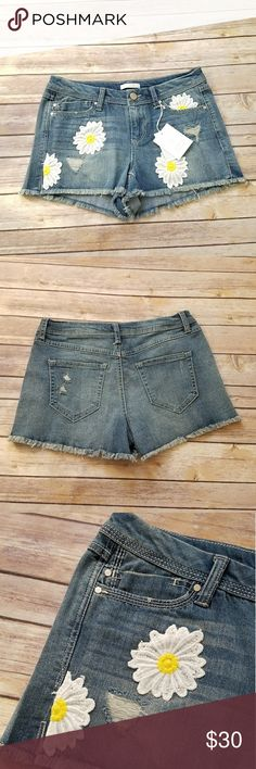 NWT Lauren Conrad daisy denim cutoff shorts Size 4. LC Lauren Conrad denim cutoff short shorts. Embroidered daisies on the front pocket. New with tags! LC Lauren Conrad Shorts Jean Shorts