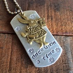 """Hey, check out what I'm selling with Sello: """"Once upon a time"""" hand stamped dog tag inspired by Alice in Wonderland http://marahjohnsondesigns.sello.com/shares/qndMp"""