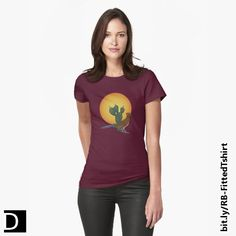 This women's fitted t-shirt features a drawing of a southwest desert roadrunner in front of a cactus and a large hot sun. Available from Redbubble in 18 colors and 5 sizes. https://www.redbubble.com/people/debidalio/works/12140864-soul-of-the-southwest?p=t-shirt&style=womens #StudioDalio colorful apparel casual clothing clothes shirts