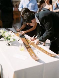 Snow in Love: Ski Resort Wedding Inspiration |  Instead of a guestbook, try a set of skis or a snowboard for guests to sign!