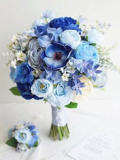 Brides who choose blue wedding bouquets have, not surprisingly, a great affinity for flowers. After all, no matter what shade of blue a bride chooses, this hue Bridal Bouquet Blue, Spring Wedding Bouquets, Flower Bouquet Wedding, Blue Bridal, Navy Blue Wedding Theme, Wedding Colors, Wedding Ideas, Sky Blue Weddings, Wedding Day Wishes