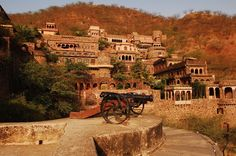Neemrana Fort Palace, Neemrana, Rajasthan: In the dusty northern Rajasthani plains, a few hours' drive south from Delhi, lies the town of Neemrana, overlooked by a 13th century hilltop fort. In 1991 the fort was opened as a hotel after a painstaking resoration, and now it is one of the favourite destinations for city-weary weekenders. It has been added to over the years but retains its ancient look and feel, and is full of nooks and crannies to explore.
