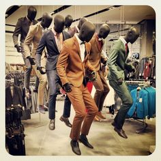 This is one of the most brilliant ideas that have come along in a very long time. If the store needs to attract a younger crowd, hanging the mannequins in a motion setting is a great way to do it. These are not suits for old men! Suited male mannequins at Top Man in London. #retail #merchandising #mannequins #menswear