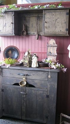 Primitive cabinet, no doll,flowers or plant.. Replace with grape vine and replace plant with sweet annie and no birdcage