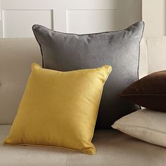 My living room color scheme. Gold, grey (charcoal), cream (or white - not sure yet) and brown. Going to throw in a touch of gray/blue with the pillows and decor as well.  Just got a new couch in charcoal...so excited : ) yellow pillow from ikea