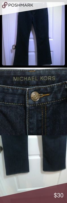 """Michael Kors Jeans Dark wash Boot cut Michael Kors jeans.  These jeans are in great condition. Hems are in perfect condition. Back label has some wear shown in pictures.They are size 4. Materials are 67% cotton,  32% polyester,  and 1% spandex.  Inseam is 29"""". Michael Kors Jeans Boot Cut"""