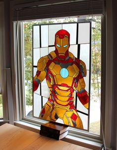 R. Evan Daniels of Martian Glass Works has created a series of video game and comic book superhero themed stained glass panels. This Iron Man stained glass panel took over 100 hours to create and uses approximately 334 pieces of glass, 275 feet of copper foil and 5 rolls of solder.