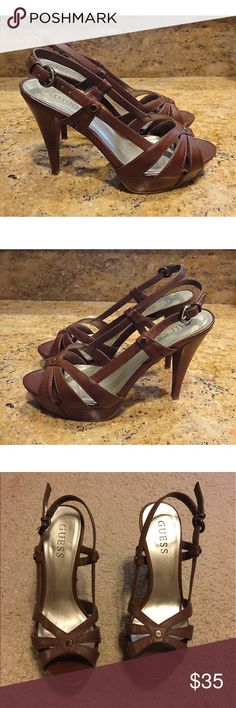 GUESS Brown Leather Sandals A pair of GUESS slingback sandals! Size 5.5 Medium. Brown. 4 1/2 half heels. Excellent condition with minor wear on the soles. FABULOUS footwear for spring and summer! Guess Shoes Sandals