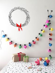 Festive and fun advent calendars: DIY Christmas Bulb Advent Calendar project from The House That Lars Built will brighten your Christmas countdown! Christmas Lights Garland, Paper Christmas Decorations, Easy Christmas Crafts, Christmas Projects, Simple Christmas, Handmade Christmas, Christmas Bulbs, Beautiful Christmas, Origami Christmas