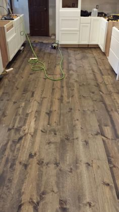 This is rustic 1x8 pine flooring stained with Minwax Jacobean. We haven't put the finish on yet but it's so beautiful already. Very affordable to at about 1.25 s.f.hard costs.