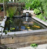 A raised pond like this brick one makes caring for the fish and the ...