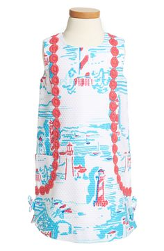 How adorable is this little girls Lilly Pulitzer dress? Love the lighthouse and seaside print!