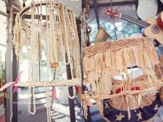 VINtage lampshades turned into chandeliers for MIRanda LAmbert & BLake Shelton's wedding using a $5 lamp cord!!! and a TON OF old pearl necklaces!!!