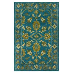 Anchor your living room seating group or define space in the den with this artfully hand-tufted wool rug, featuring a Persian-inspired motif for timeless app...