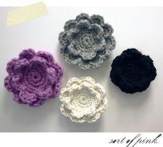 Sort of pink.: Crocheted flower.