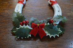 Christmas is just around the corner! Perfect as a gift or for your own home. Horseshoe is white with Christmas red ribbon, bow and holly tree leaves. Perfect as wall decor or even your front door