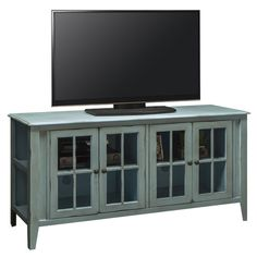 "Features:  -Dado construction.  -Material: Premium select veneer and solid wood.  -Bess collection.  Country of Manufacture: -United States.  TV Size Accommodated: -70"".  Product Type: -TV Stand.  Des"