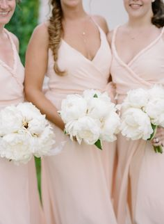 Delicate white peonies + blush bridesmaids: http://www.stylemepretty.com/2016/02/22/ballerina-chic-from-top-knot-to-toes/