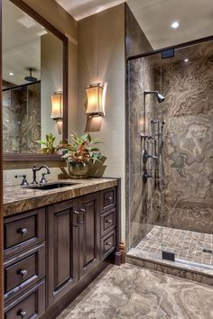 Take a peek inside this luxurious marble tile bathroom with a glass enclosed shower at HGTV.
