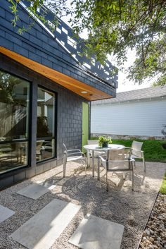 Because of the protected tree much of the yard had to remain undisturbed.  This was a difficult challenge for the architecture but it means that the yard is open and usable.  Photo: James Bruce #architecture #tomhurtarchitecture #modernarchitecture #design