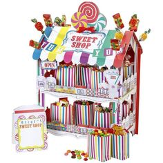 Sweet Shop Rainbow Treat Stand ($21) ❤ liked on Polyvore featuring home, home decor, retro home decor, mini candy jars, candy jars, paper centerpieces and candy centerpieces