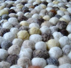 I first saw this type of rug in a design magazine, it was called Hay Pinocchio Rug. It was gorgeous the felt balls were made from brightly coloured wo...