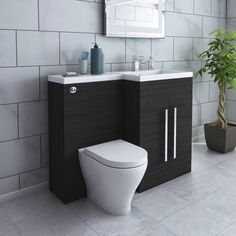 Dark wood finishes create a sleek look! Combination Vanity Units, Toilet And Basin Unit, Grey Vanity Unit, Concealed Cistern, Back To Wall Toilets, Basin Taps, Grey Furniture, Sleek Look, Dark Wood