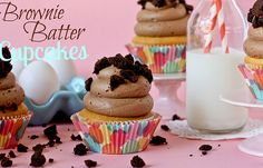 Brownie Batter Cupcakes -- cake mix with brownie batter (from a mix) inside, topped with brownie frosting.