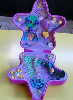 I still remember getting this for Christmas. I had already figured out what it was by sizing up the box that was wrapped at home and then sizing up boxes at Wal-Mart. Mom tried to make me think that I had no idea what I was talking about.     God, I loved that Polly Pocket