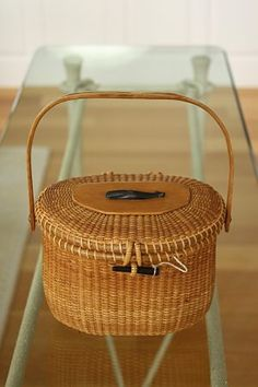 Nantucket Lightship Basket ( in detail with ebony whale ornament below left), a creel-style handbag, made by Jose Formoso Reyes in the Nantucket Baskets, Nantucket Island, Bountiful Baskets, Fibre And Fabric, Wicker Baskets, Sewing Baskets, Weaving Art, Basket Weaving, Rattan