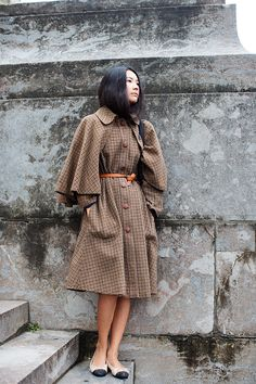 A very Sherlock Holmes looking coat. It's gorgeous! And love that she's not wearing heels, not all women wear heels all the time.