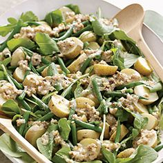 Arugula, Potato, and Green-Bean Salad with Creamy Walnut Dressing    The satisfying crunch of walnuts gives a helping of salad greens added dimension; the nuts have a natural affinity for arugula, spinach, endive, and watercress.