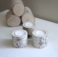 Beautifully simple birch wood candles for scandinavian style weddings! So simple yet beautiful table decorations and atmosphere builders