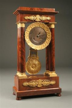 19th Century French Empire Portico clock in mahogany case with bronze mounts, circa 1810. #antique #clock