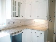 I've been thinking of having a white subway tile backsplash, and also plan on using some white subway tile in my bathrooms along with the vintage hex tiles in my bathrooms. All the amazing pictures here help so much.. but I can't determine what white is being used mostly. My cabinets will be an off ...