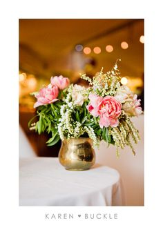 Relaxed brass vase design with double tulips and Andromeda. Image by Karen Buckle photography