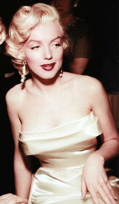 DO embrace old style Hollywood Glamour like Marilyn Monroe in 1953. Drop pearl earrings are a must!