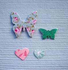 craft supplies / hand punched paper shapes /assortment of paper shapes/ paper punched hearts / paper punched butterflies / uk seller