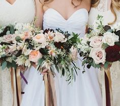 The bridesmaids will carry average-sized, round bouquets of white hydrangeas, blue succulents, wine-colored ranunculus, blush spray roses, and subtle hints of silver dollar eucalyptus, dusty miller wrapped in champagne ribbon with the stems showing (no hanging ribbon, and the greenery will not be as flowing as pictured).