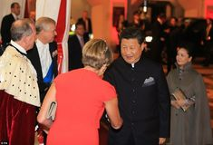 Lady Mayoress Gilly Yarrow greets the Chinese president, who is followed by his wife, on the second day of his state visit to the UK