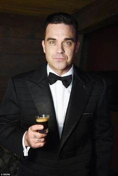 Coffee connoisseur: Robbie Williams spoke about his family life on the set of his new advertisement for coffee brand, Café Royal, which is set to air on Australian screens on July 16 New Advertisement, British Celebrities, Robbie Williams, British Boys, Coffee Branding, Most Handsome Men, Rock Style, Hollywood Stars, Pop Group