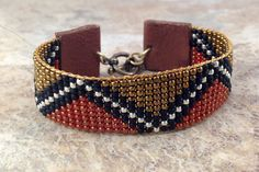 African textile inspired, Ethnic, Tribal loom beaded bracelet, 11/0 glass seed beads, leather tabs, brass toggle clasp