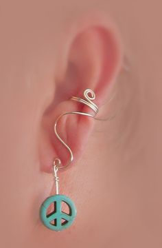 Ear+cuff+with+turquoise+peace+symbol+by+TheLazyLeopard+on+Etsy,+$12.00